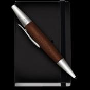 A pen set diagonally across a closed notebook.